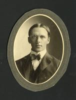 Oval photograph of young man in bow tie