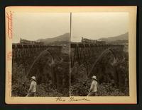 Rio Grande : man standing in front of bridge with locomotive on the bridge