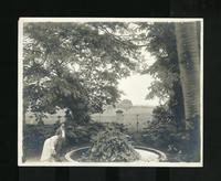 Man and woman near circular fountain