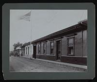 """Street view in front of a building.  On verso: """"U.S. Legation, San Jose, Cosa Rica.  Street front view ... 1904. No.356 Calle Central Norte"""""""
