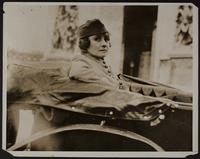 blow ups of 3x5 photo of Peggy in WWI uniform and a man and a woman in a car (2 copies)