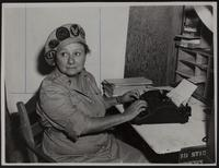 Photo of Peggy at a typewriter