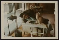 Snapshot of Peggy in old age with a cat