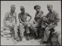 5x8 photo of Peggy with three soldiers at Kawajalein, WWII