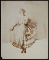 Photo of Peggy in a frilly dress with sash and tiers