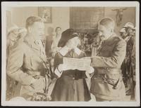 6x8 photo of Peggy and British (?) Army Officers looking at an Arabic newspaper