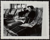 Photo of Peggy having tea on board a ship sitting in a deck chair (1 of 2)