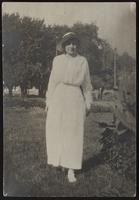 Photo of Peggy in long white dress