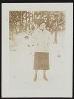 Photo of Peggy in white coat in woods (1 of 2)