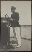 Photo of Peggy's first husband John Kinley at a ships instruments and speaking tube