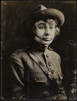 7x9 photo of Peggy in uniform, hat with chin strap