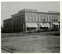 State Bank, Nathan Frank Groceries, and Theo. Pohler Groceries - Southeast Corner of 9th & Massachusetts St.