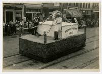 KU, The Cosmopolitans float (75th Anniversary Historic Parade)
