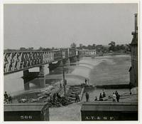 Toll bridge and dam with crowd watching by mill (1876 Flood)