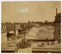 Close-up of bridge across Kaw River at flood stage, Douglas County Mills at right (1876 Flood)