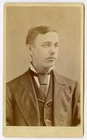 Portrait of a young man without facial hair wearing a tie