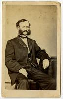 Portrait of a sitting man with mutton chops and a mustache