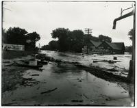 High water in street near The Palace store (1903 Flood)