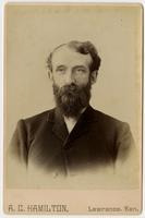 Portrait of a man with dark full facial hair