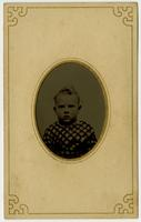Portrait of small boy with crosshatch shirt, framed by mat