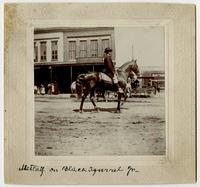 General W. S. Metcalf with Black Squirrel, Jr. [horse] on Massachusetts Street