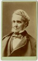 Portrait of an old man with bowtie and sideburns