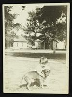 Unidentified boy with dog