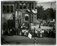 Crowd in front of prop buildings (Semi-Centennial Parade)