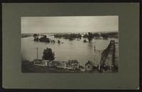 Looking north over river with people at bridge (1903 Flood)