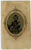 Portrait of infant in a dress, ornate frame design
