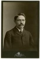 Portrait of a man with mustache and glasses