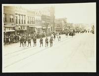 Police, two Native Americans, buffalo from University of Kansas [KU] museum, and KU band (75th Anniversary Historic Parade)