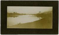 Looking east towards second bridge and Bowersock Mill and south bank at sunset, before 1903 flood