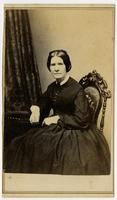 Woman with black dress on decorative chair