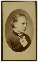 Portrait of woman with black ribbon cross necklace