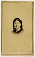 Portrait, small image of woman with glasses, dark hair and lacy headpiece