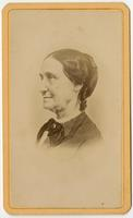 Portrait of old woman with black bow on collar