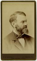 Portrait of man with sideburns, mustache, and beard