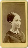 Portrait of a woman with a braided bun and white lace collar