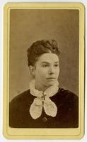Portrait of a woman with a braided updo and a frilly white collar
