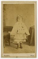 Photo of child with boots, hat, and muff