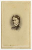 Small portrait of a woman with a long curl and dangling earrings