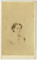 Small portrait of a woman with dark curly hair