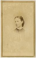 Small portrait of a young woman with pulled back hair