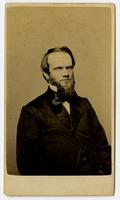 Portrait of a man with a beard and high collar