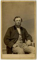 Portrait of a man with a beard and unbuttoned jacket