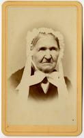 Portrait of old woman with lacy cap and white bow