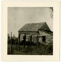 Log House with Windmill in Background