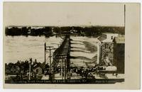 Crowd looking north over dam at Bowersock Mill (1908 Flood)