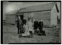 Unidentified Family in Front of Homestead